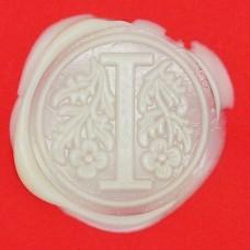 Creamy white wax, pellets